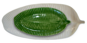 Paired colour options of the small banana leaf plate and large banana leaf platter, in glazes green and white