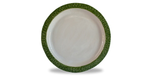 Breadfruit dinner plate with breadfruit textured rim and creamy glaze in bowl of plate.