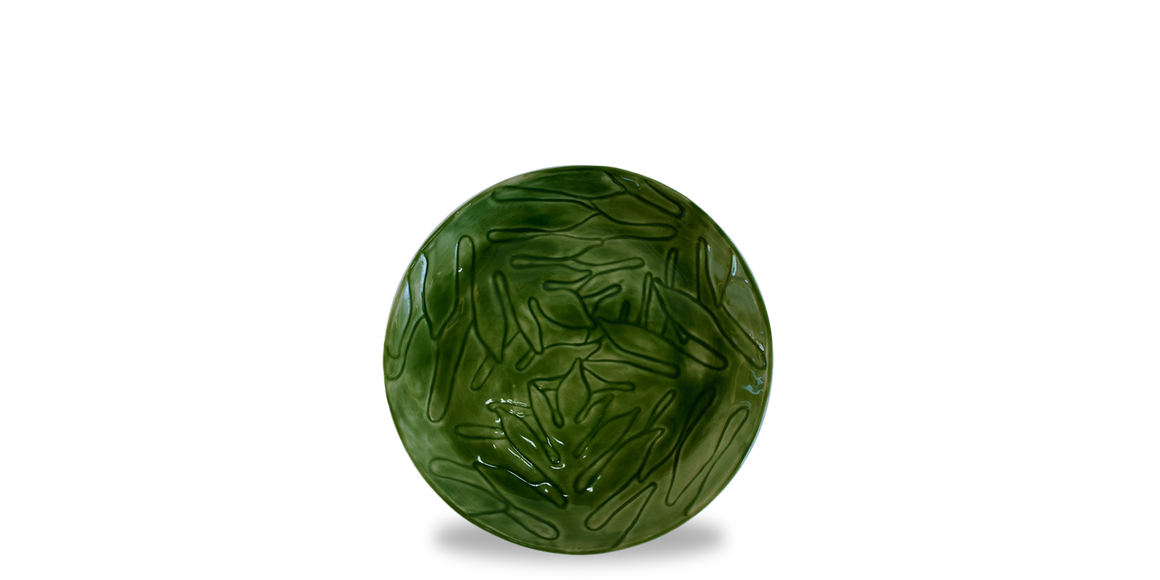 Breadfruit leaf etched pattern in a salad plate glazed in a vibrant green to mimic the leaves of a breadfruit tree.  Stunning example of modern Jamaican pottery and Jamaican ceramics