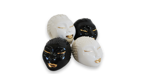 Handmade salt and pepper shakers in white and black with 18 karat gold lips and eyelashes