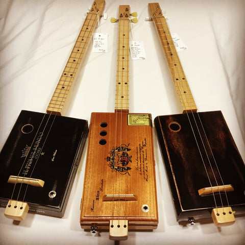 Cigar Box Guitars handmade by Mike Snowden in his shop Marietta GA USA.