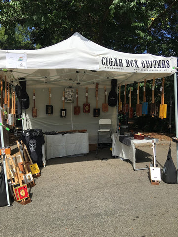 Mike Snowden's cigar box guitar booth at inman Park festival atlants GA USA Snowden Guitars.