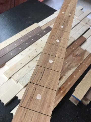 Fret slots cut handmade Cigar Box Guitars by Mike Snowden of Snowden Guitars.