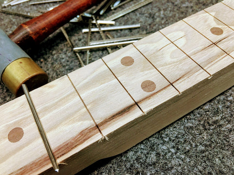 Mike Snowden cigar box guitar getting frets installed at Snowden Guitars hand made guitars.