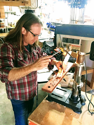 Handmade cigar box guitars with Mike Snowden of Snowden Guitars. Drilling tuning peg holes today!
