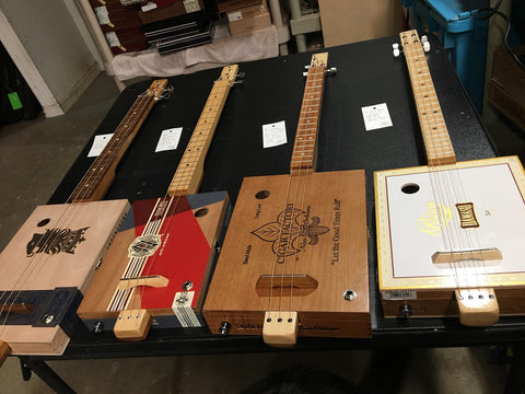 New batch of cigar box guitars handmade by Mike Snowden of Snowden Guitars