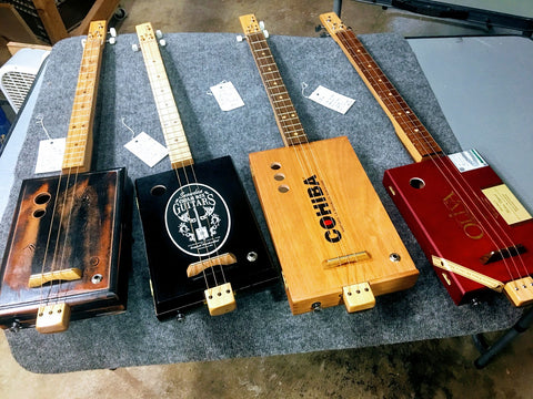 Cigar box guitars by mike Snowden of snowden guitars for sale.