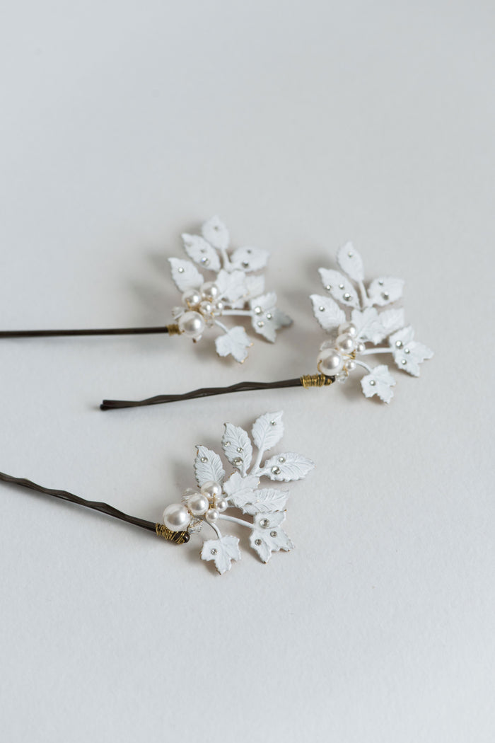 White bridal hair pins with crystals and pearls