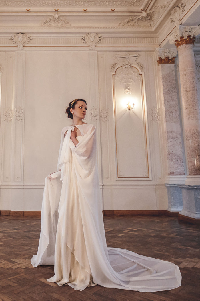 bride with long ivory wedding cape