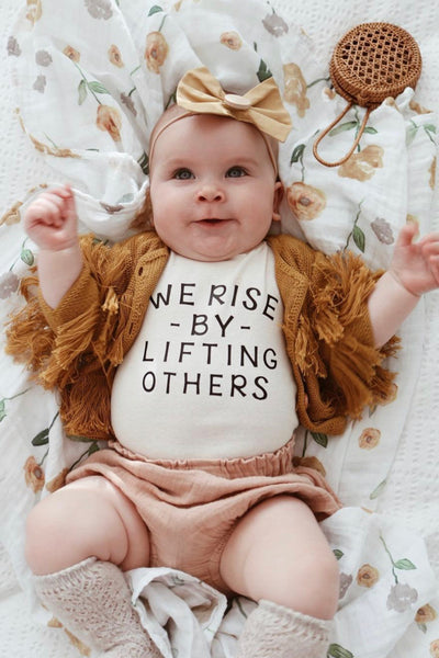 We Rise By Lifting Others - Onesie