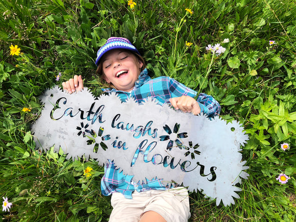 Earth laughs in flowers - Sign