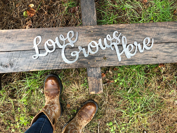 Love Grows Here Rustic Raw Steel Cursive Metal Word Art Sign