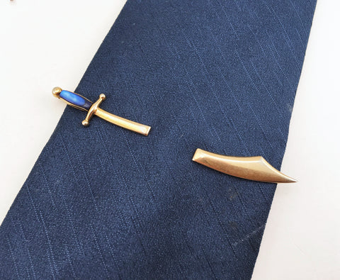 "1970s Swank Sword or Scimitar Tie Bar Gold Tone Metal & Blue ""Stone"" Sword Shaped Tie Clip by SWANK"