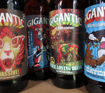 Four different Gigantic Brewing beers waiting for consumption