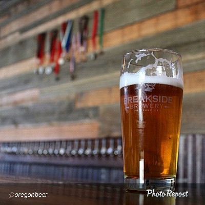 A partially consumed pint of beer from Breakside Brewing