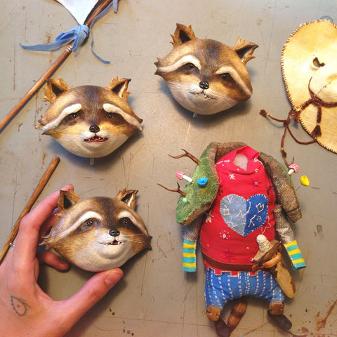 Tolly author and artist Maryanna Hoggatt creating hand-sculpted heads for Tolly the battle raccoon sculpture