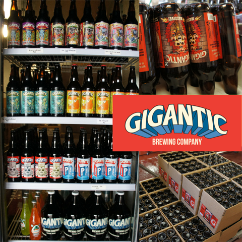 Lots of Gigantic Brewing bottles and growlers