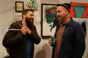 J Shea and Zac Johnsen catching up at The Tall Trees of Portland artist party at Hellion Gallery