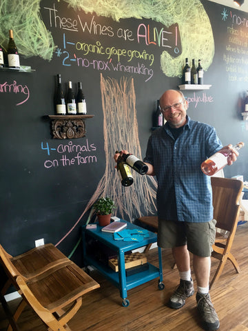 Jeffrey Weissler at Pairings Portland holding his top three wines for June