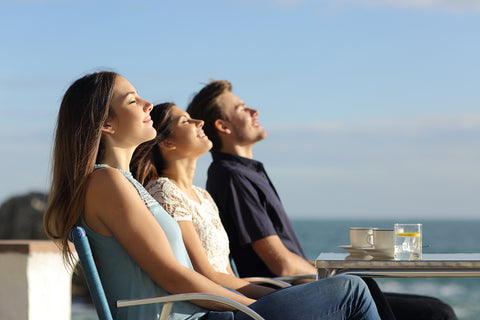 3 happy meditating people