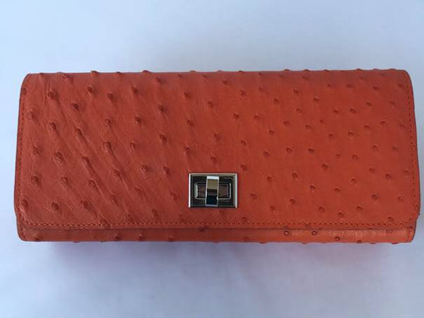 Orange ostrich clutch with silver hardware