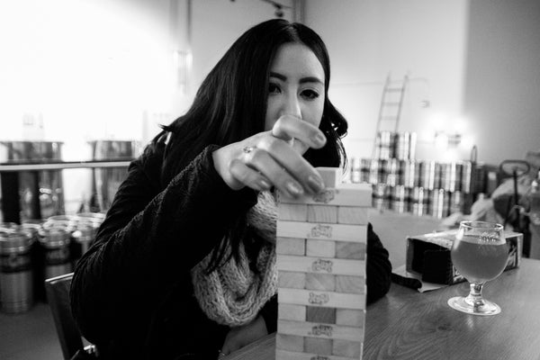 Anjelica playing Jenga at LoveCraft Brewing Co.