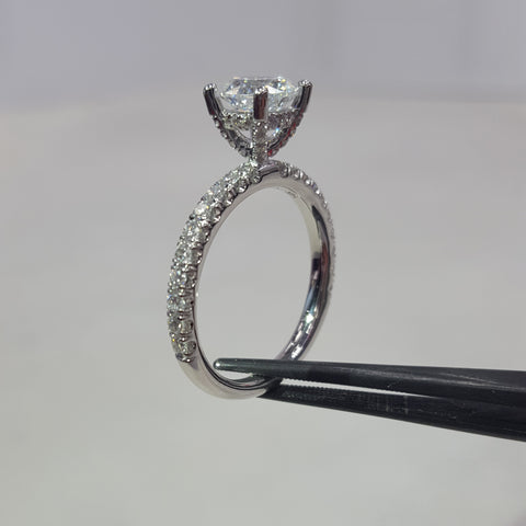 Engagement Ring with Diamonds on Prongs