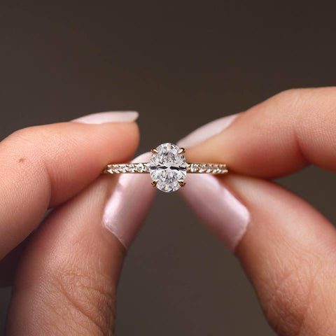oval engagement ring with clawed prongs
