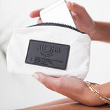 mini white pouch, black label