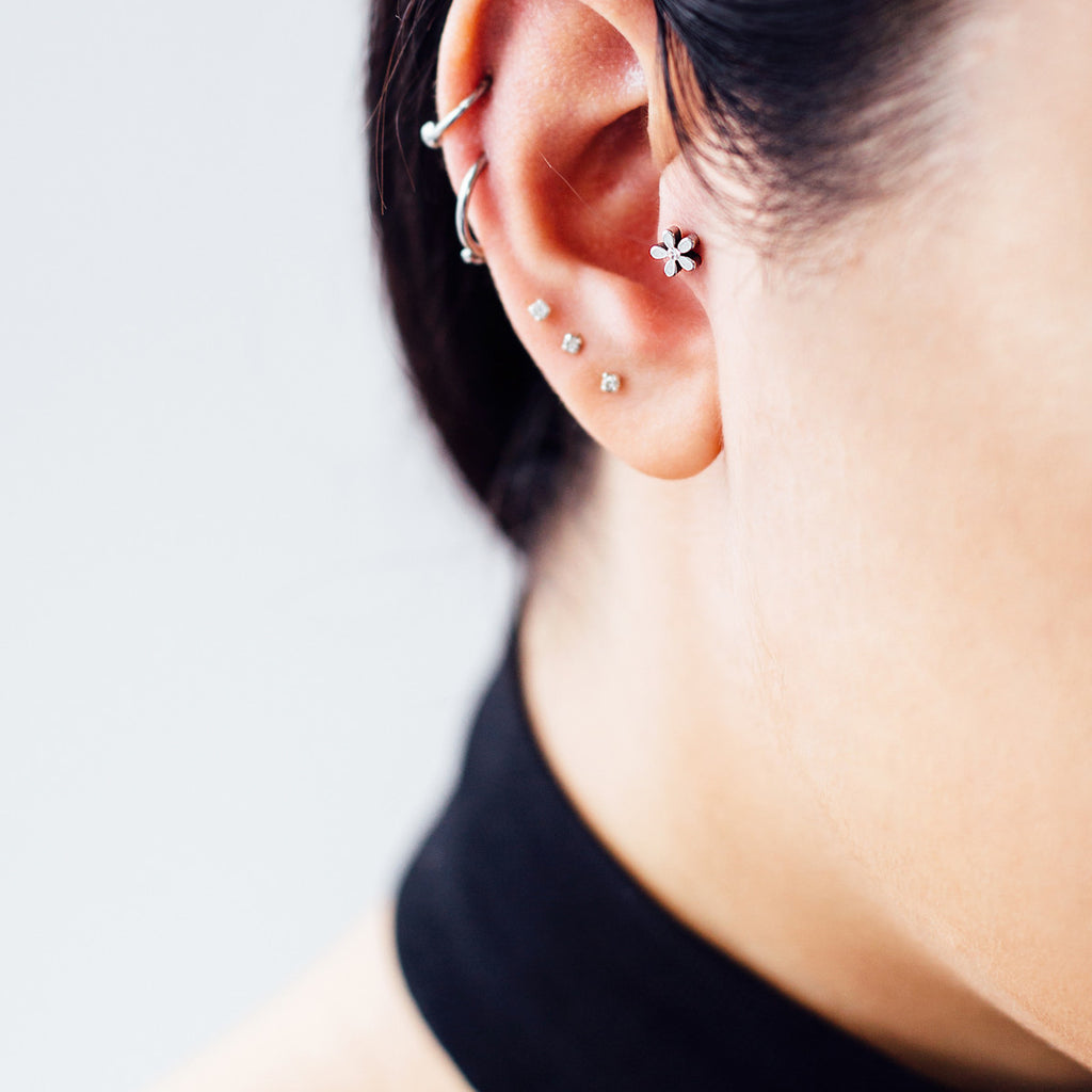 Floral Tragus Helix & Cartilage Piercing on model - silver