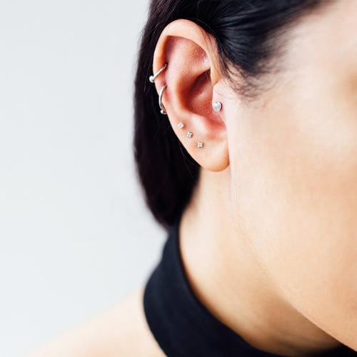 Heart Tragus & Cartilage Piercing on model - silver