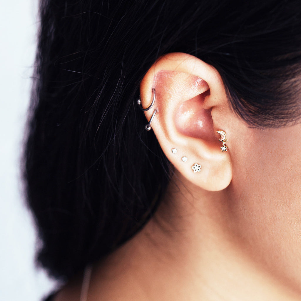 Orbit Star and Moon Piercing on model - rose gold