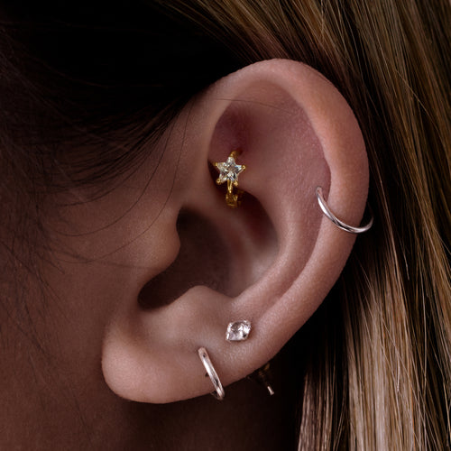 Sparkle Star Gem Hoop Ear Piercing on model - 10KT solid gold