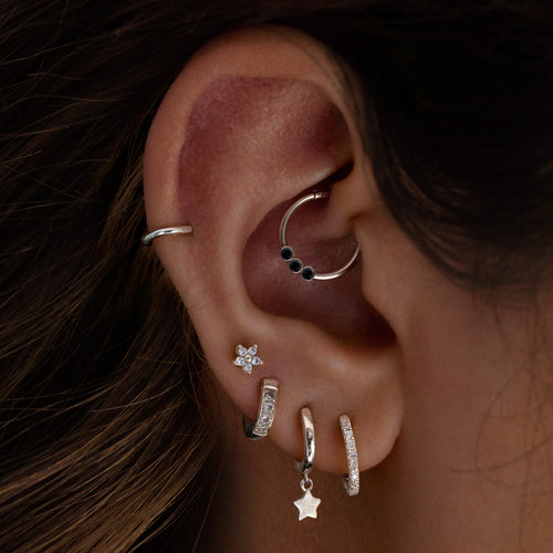 Triple Gem Cartilage Hoop Piercing on model - onyx