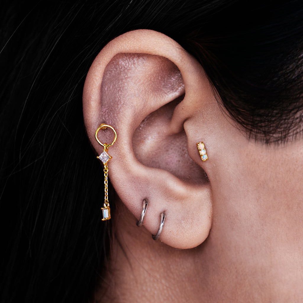 Absolute Triple Opal Tragus Ear Piercing on model - gold