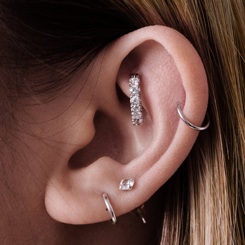 Apex Hoop Ear Piercing on model - silver