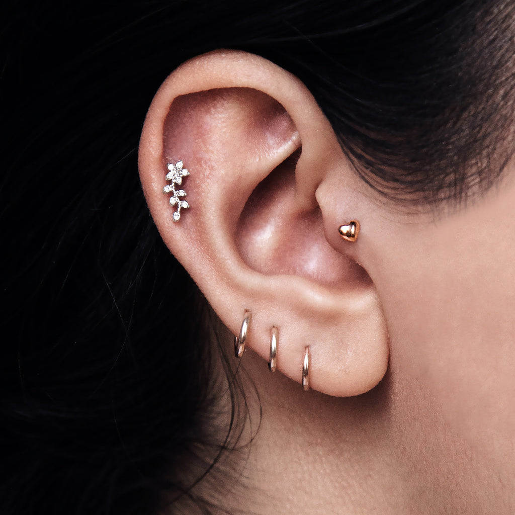 Bloom Flower Tragus Helix & Conch Ear Piercing in model - silver