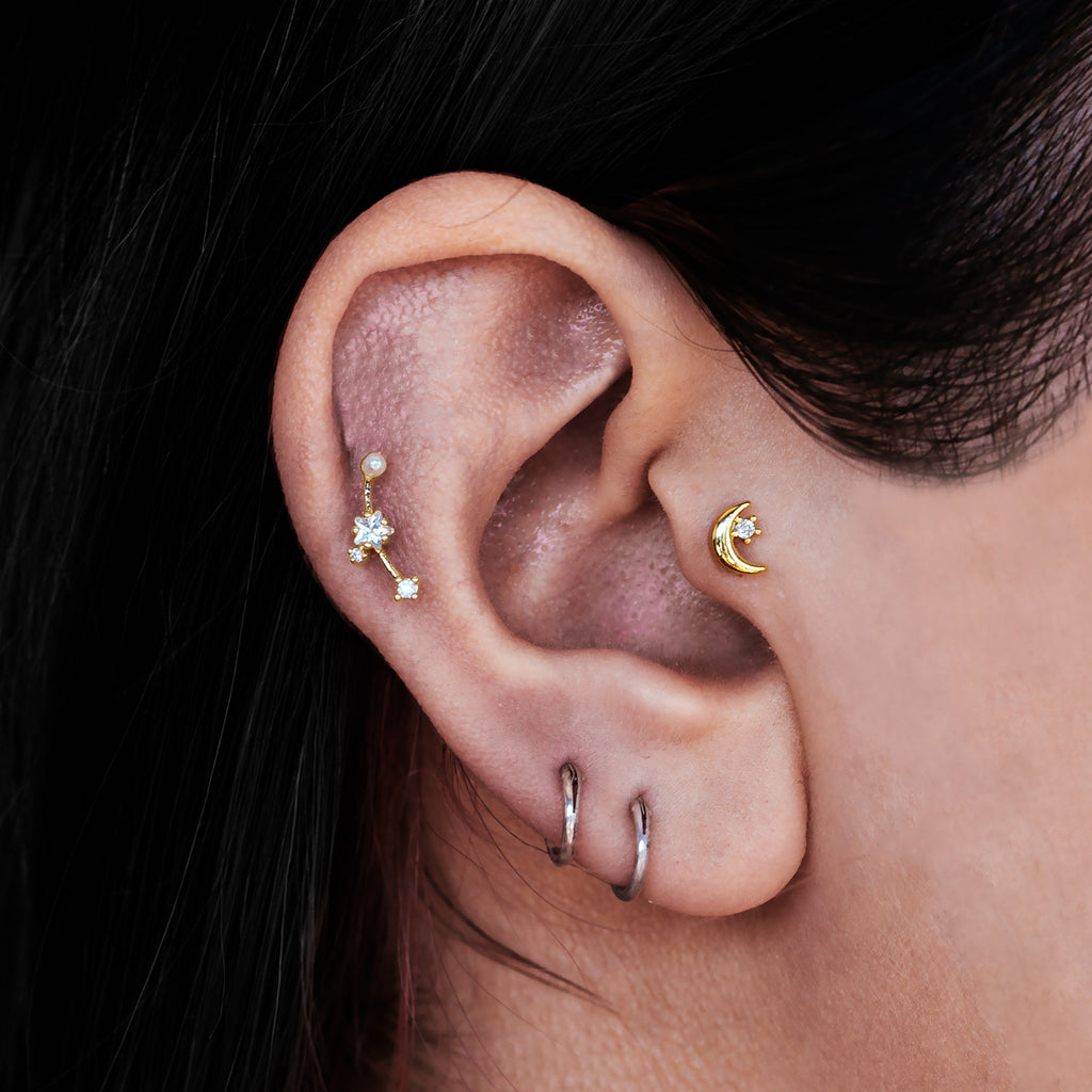 Celeste Moon Tragus Helix & Conch Ear Piercing on model - gold