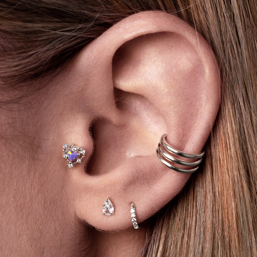 Covet Heart Tragus Helix & Conch Piercing on model - silver