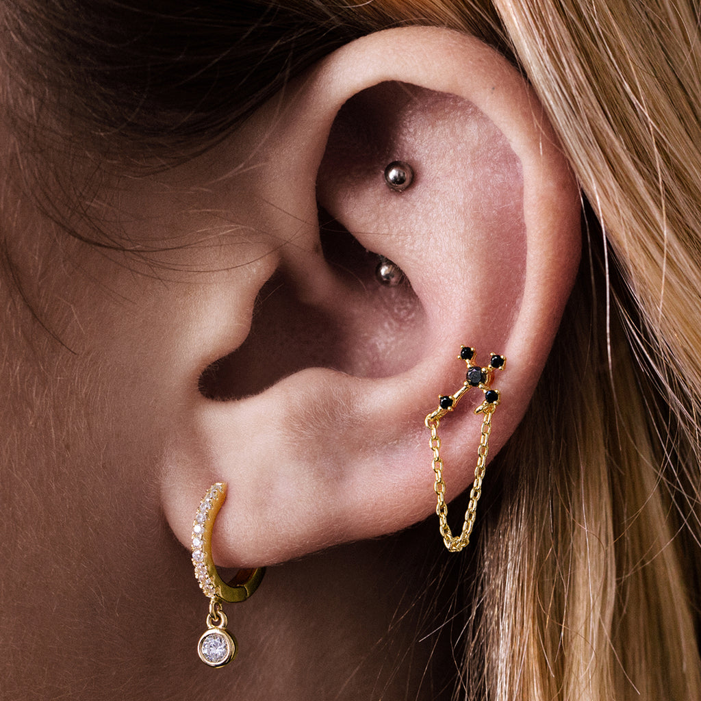 Cross Chain Helix & Cartilage Ear Piercing on model - gold