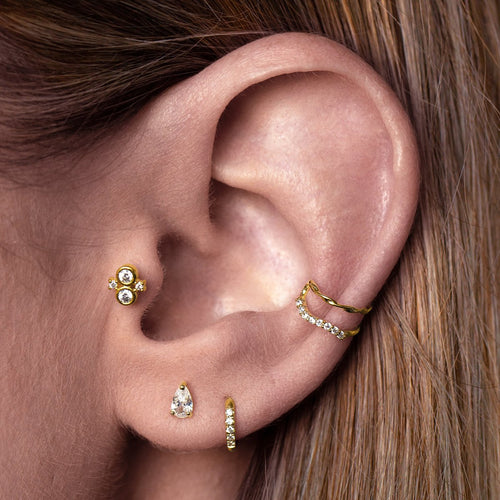 Thea Tragus Helix & Conch Piercing on model - gold