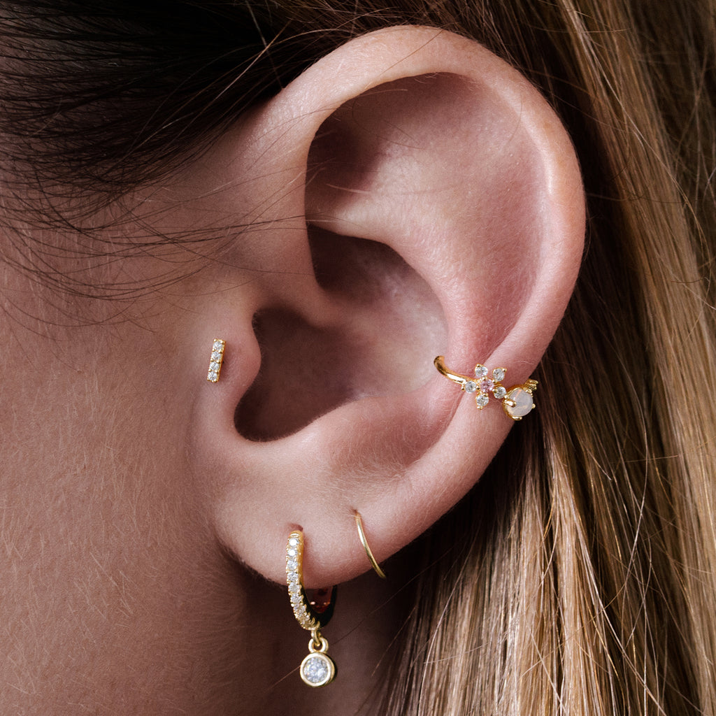 Dash Tragus Helix & Conch Ear Piercing on model - 10KT solid gold