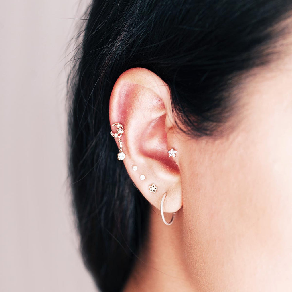 Wild Flower Tragus Helix & Conch Piercing on model - gold
