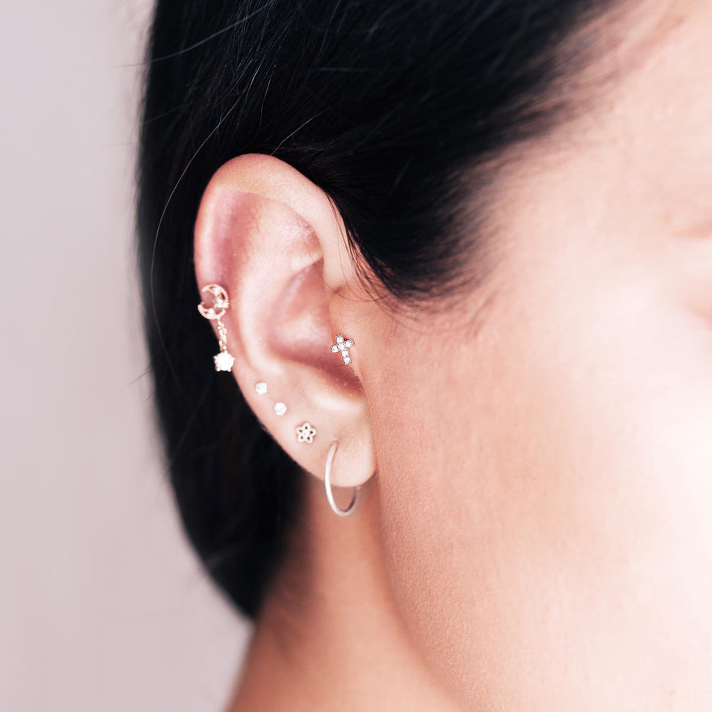 Diamonte Cross Tragus Helix & Conch Piercing on model - silver