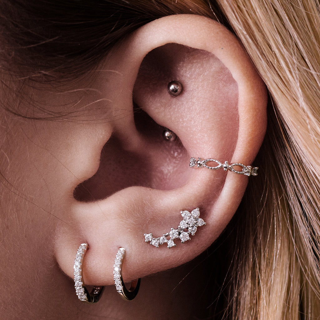 Flora Tragus Helix & Conch Ear Piercing on model - silver