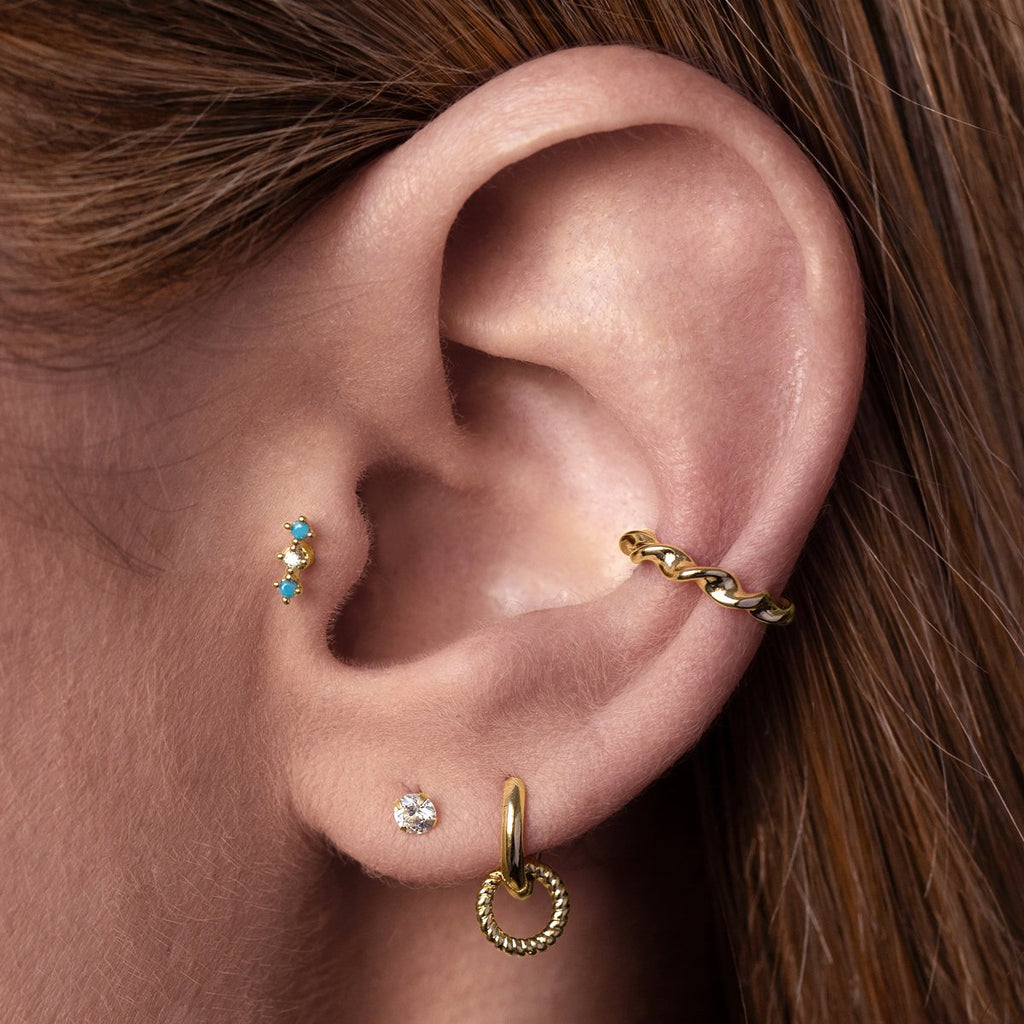 Gambit Tragus Helix & Conch Piercing on model - gold