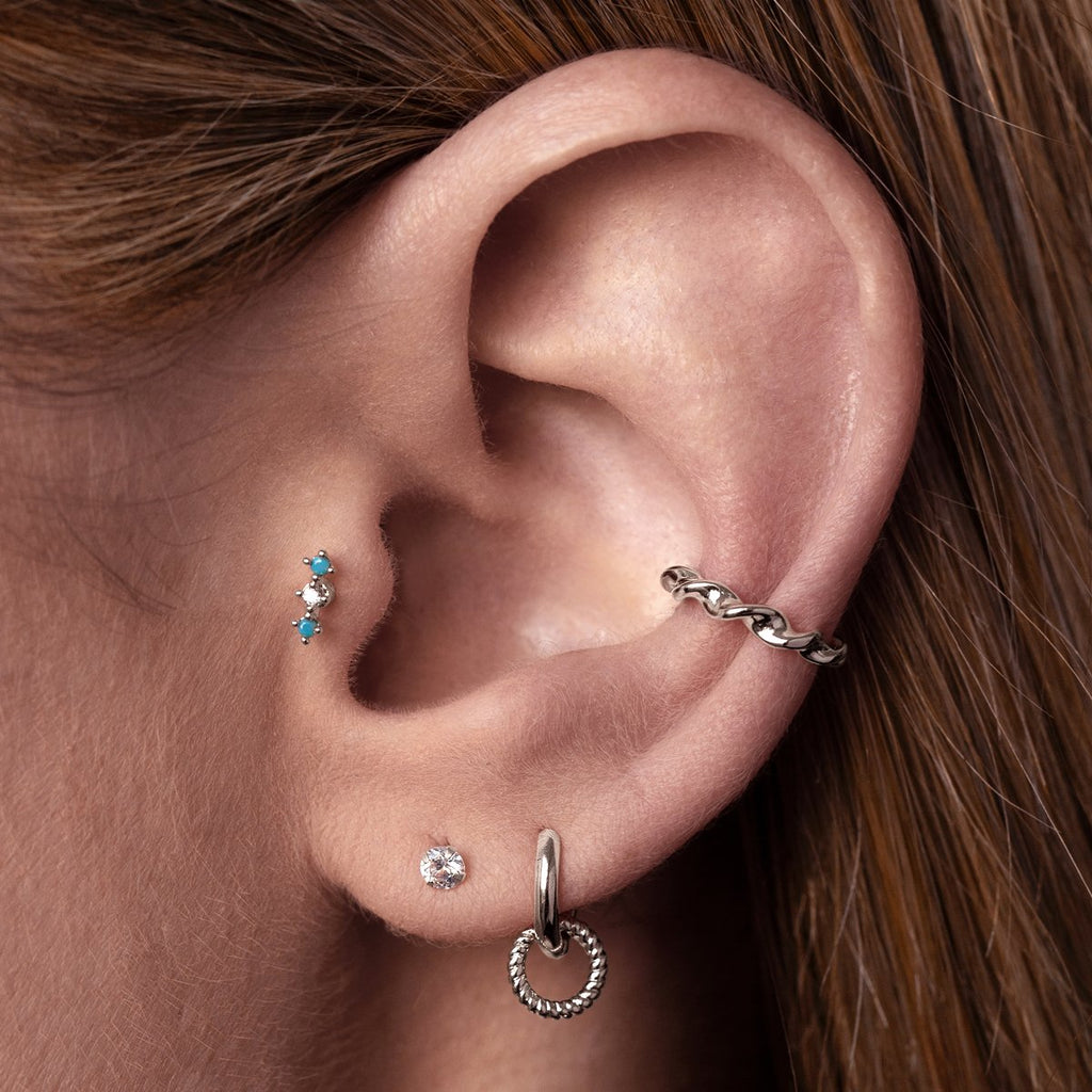 Gambit Tragus Helix & Conch Piercing on model - silver