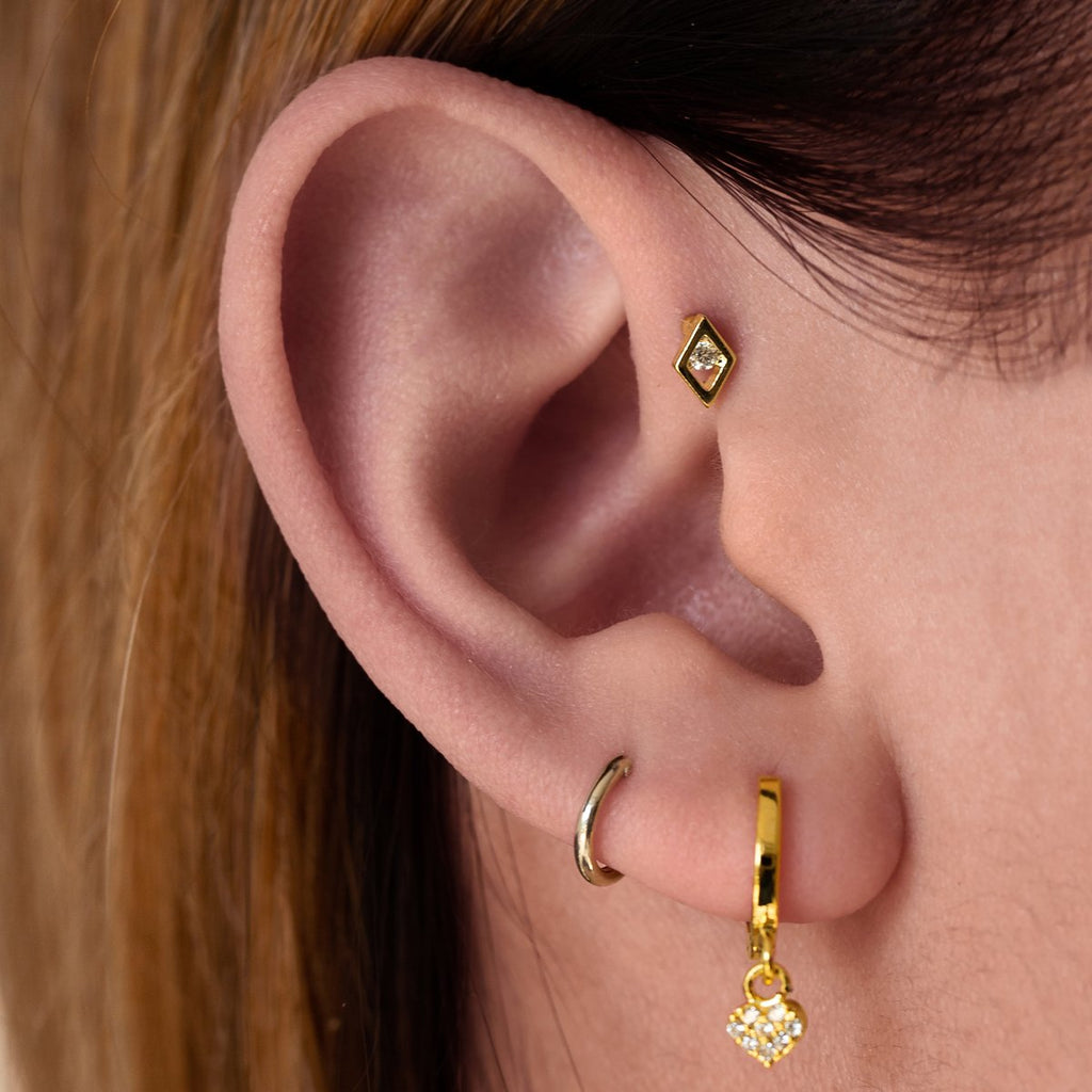 Gatsby Tragus Helix & Conch Piercing on model - gold