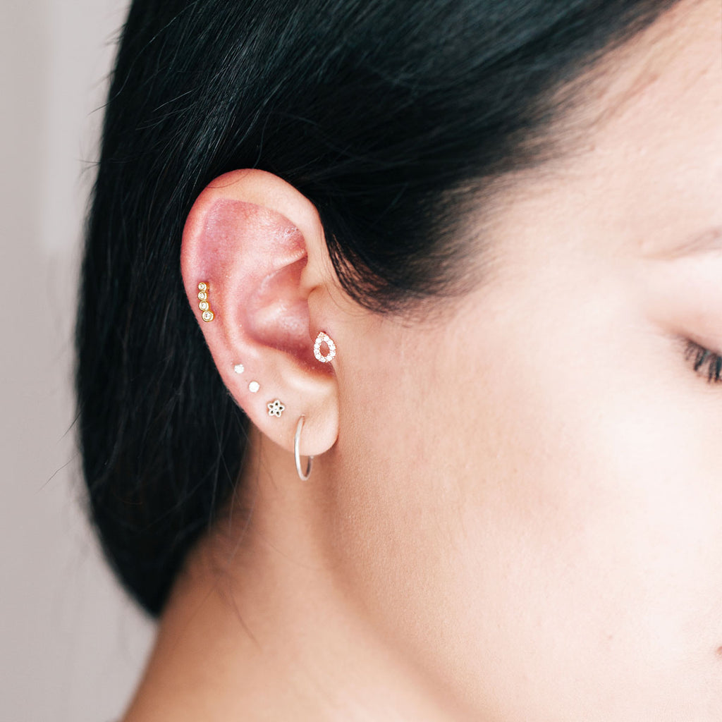 Hollow Teardrop Tragus & Helix Piercing on model - rose gold