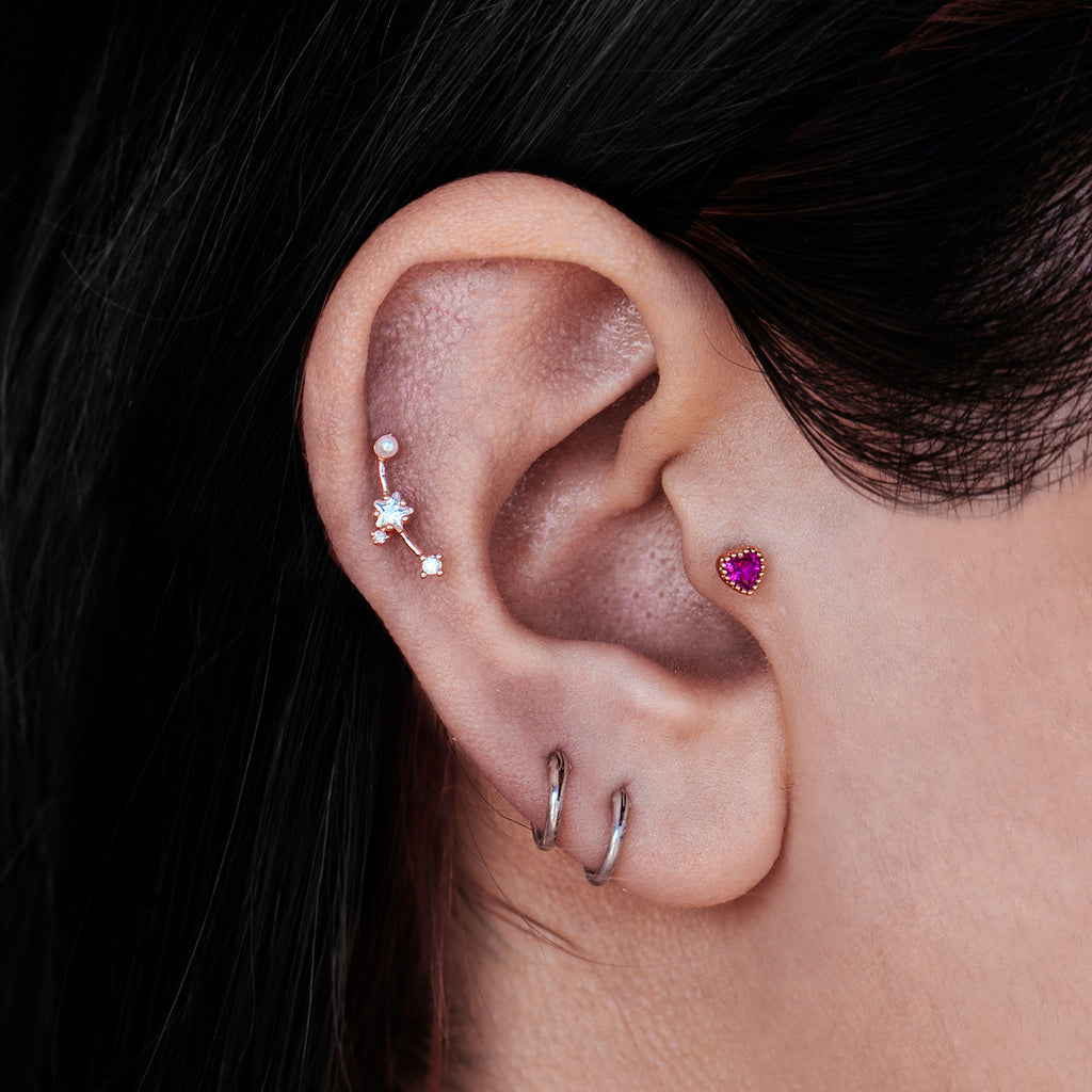 Lucid Star Pearl Tragus Helix & Conch Ear Piercing on model - rose gold
